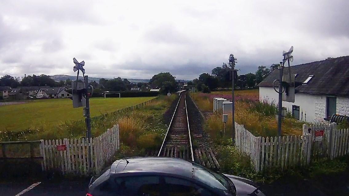 Shocking CCTV films car inches away from striking train on level crossing: Burneside level crossing CCTV near miss still (1)