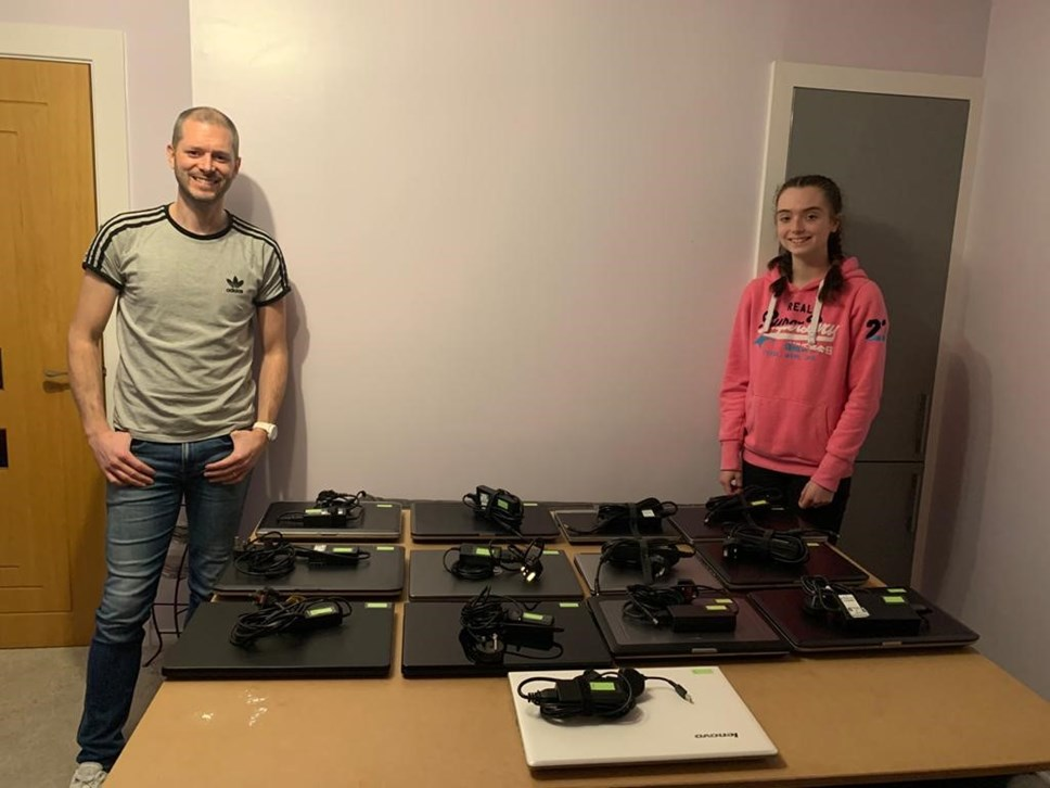Steven Dunbar and daughter, Katie, with laptops set out on table