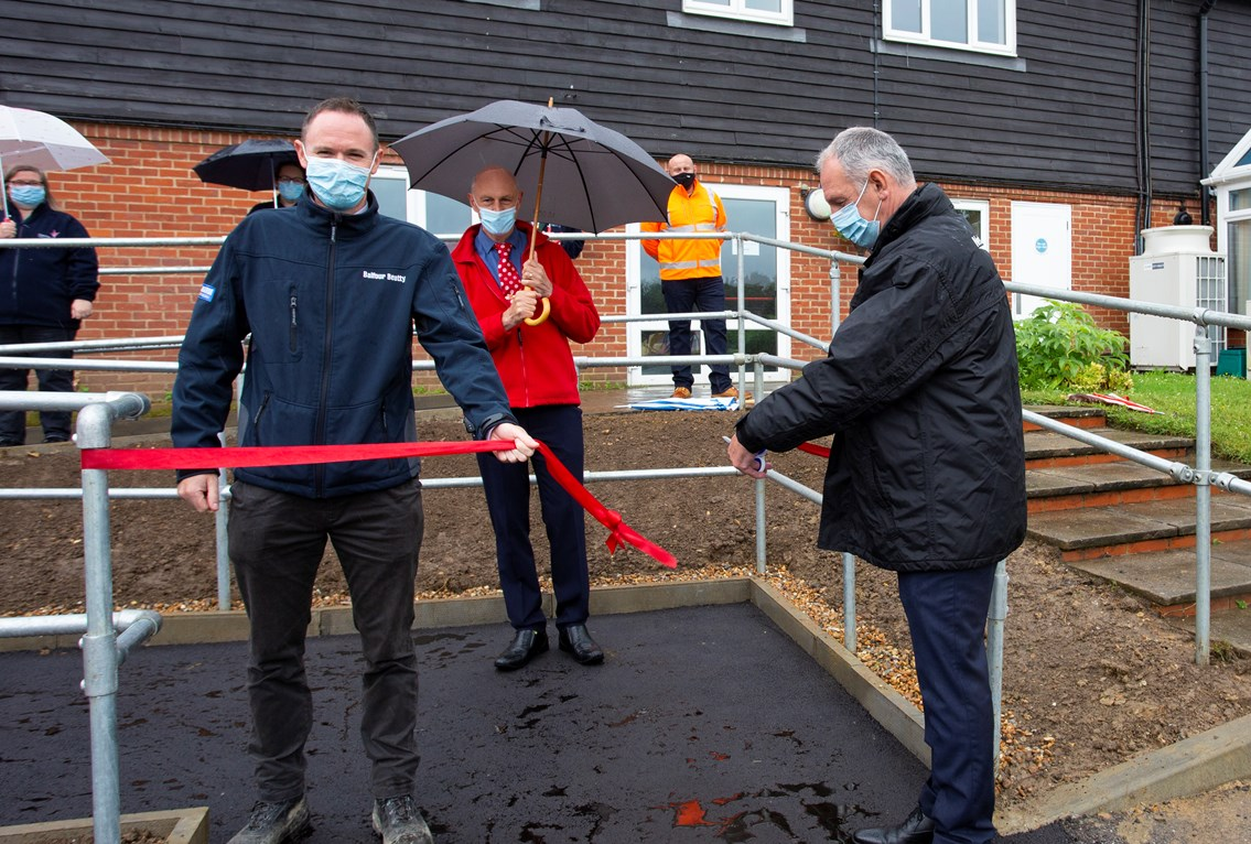 Demelzacut: Network Rail's Patrick Gallagher cuts the ribbon to open the new ramp at Demelza Kent, with Balfour Beatty's Chris Ottley
