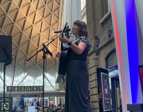 Lucy May Walker performing at King's Cross