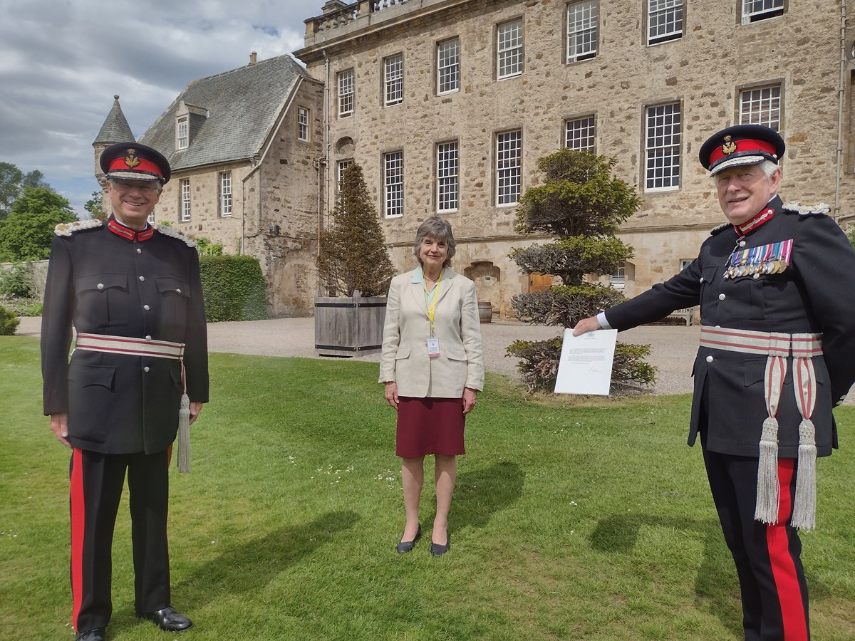 L-R: Lord-Lieutenant of Banffshire, Andrew Simpson; Deputy Lieutenant Joanna Grant Peterkin; Lord-Lieutenant of Moray, Major General Seymour Monro with the letter from Buckingham Palace