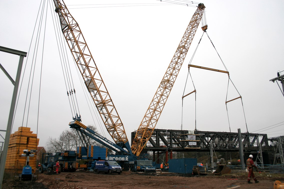 Rugby Birdcage Bridge Removal: A 1200 tonne crane prepares to lift out a 350 tonne section of the redundant 'birdcage' bridge which spanned the West Coast Main Line at Rugby.