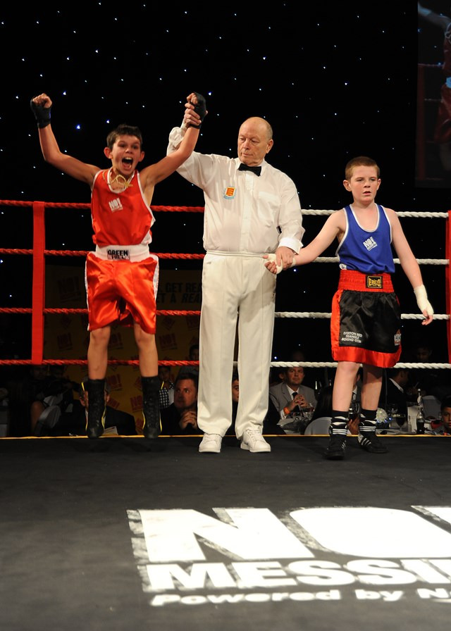 Jerry Connors (in red) from St Joseph's community club in Newport is delighted at his win over Everton boxer Lewis Gorman (in blue) at the No Messin' Tri-nation boxing competition