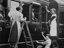 Women cleaning train carriage