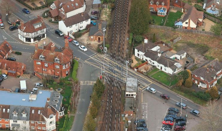 Major railway track renewal through Brockenhurst station, Hampshire, means changes to trains and diversions for motorists: Brockenhurst Level Crossing - picture by Network Rail Air Ops