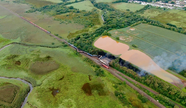 'Environmental disaster averted' as railway reopens at site of diesel freight derailment: Llangennech derailment Credit: Mighty High Aerials