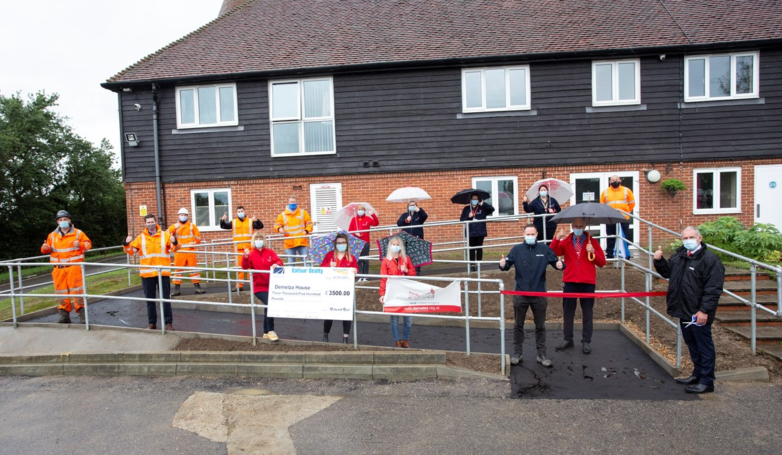 Demelza 1: Network Rail, Balfour Beatty and Seva Rail people celebrate with Demelza Hospice Care for Children ater the completion of the new disabled ramp there.