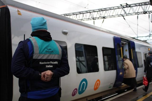 Train dispatcher at platform 14 Manchester Piccadilly
