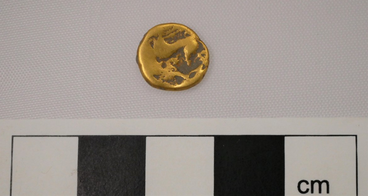 Gold Coin July 2020: Credit: Infra Archaeology  Uninscribed quarter gold stater coin from the mid 1st Century BC. Almost certainly minted in Britain. Found in the ditch surrounding the horse-shoe funerary enclosure.  Internal asset No. 16780