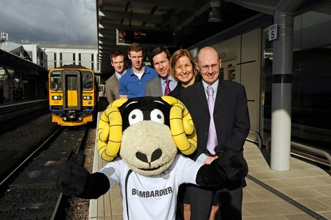 Front to back: Rammie; Martin Brown, operations risk advisor Network Rail; Dyan Crowther, route director Network Rail; Tom Glick, CEO Derby County FC; Stephen Pearson, Derby County FC player; and Richard Pedley, community safety manager Network Rail.