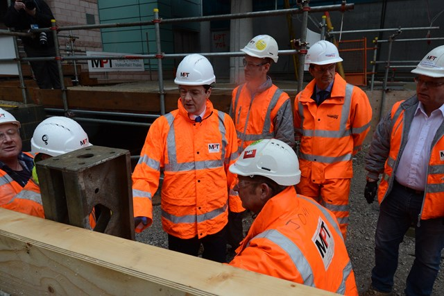 The Chancellor of the Exchequer inspects the site of a new platform at Manchester Airport station
