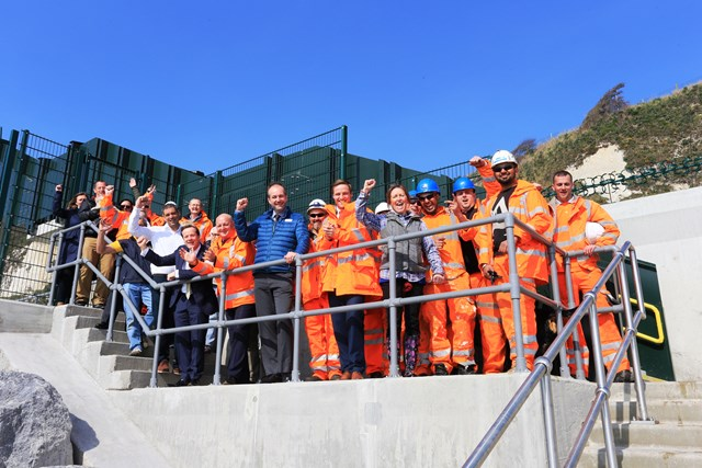 Dover -Shakespeare Beach: Residents, dog walkers, Network Rail and Costain engineers, MP Charlie Elphicke and the Channel Swimming Association celebrate the opening of Shakespeare Beach and the new footbridge access to it