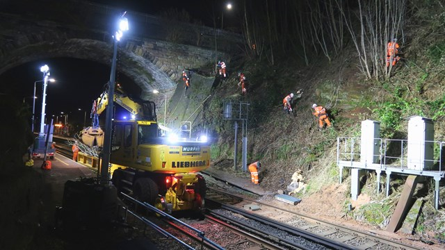 Abseiling rail workers reach new heights to keep passengers on the move: Ormskirk railway cutting work 3