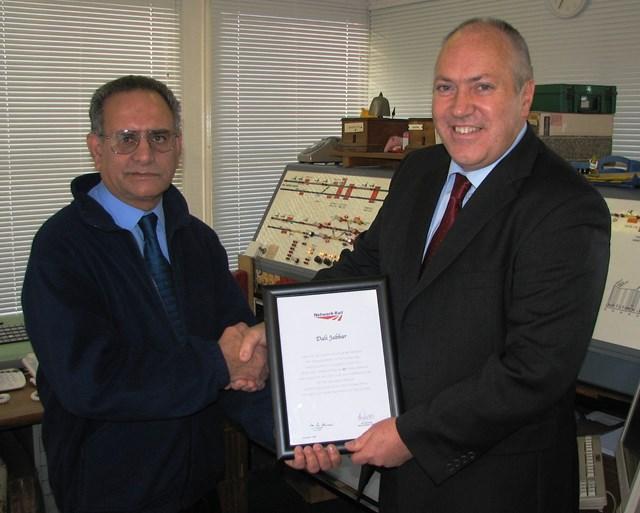 Dali Jabbar retirement: Network Rail Route Director Jon Wiseman congratulates Dali Jabbar on his retirement at Thorpe-le-Soken signal box