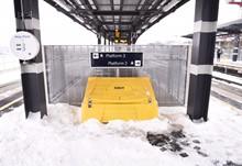 Grit bin on platform in snow at Rochester
