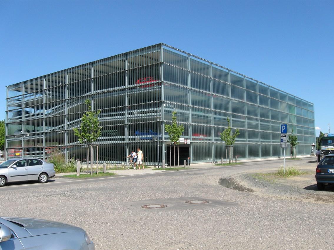 Glass-clad milti-storey car park: Photo of a glass-clad milti-storey car park in Germany, similar to that being built at Wigan North Western station.