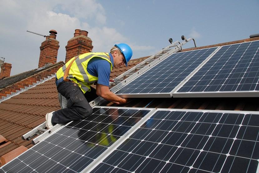 Solar panel project powers up: installingsolarpanels.jpg