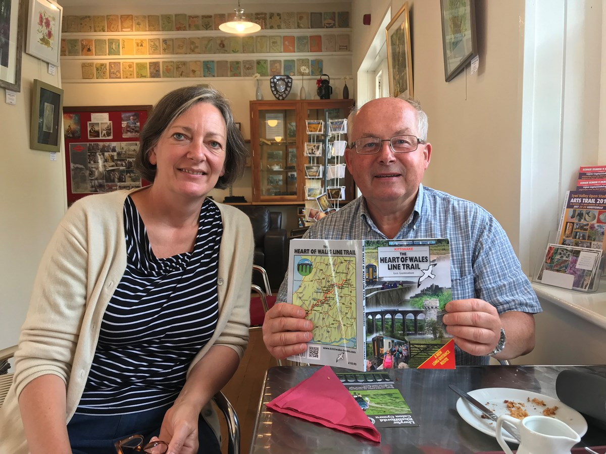 IMG 2660: Lisa Dennison, Development Officer at the Heart of Wales Community Rail Partnership pictured with a visitor to the area who recently purchased the walking trail book