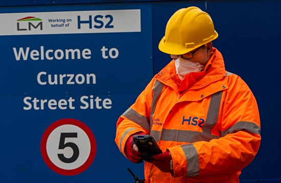 PODFather Curzon St image 2: HS2 worker at Curzon Street station site using PODFather technology.  Tags: Construction, Supply Chain, Workforce, Curzon Street, Innovation, Technology