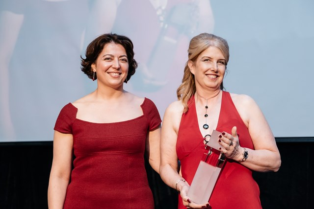 Carol Stitchman Receiving Her Award From Virginie Colaiuta