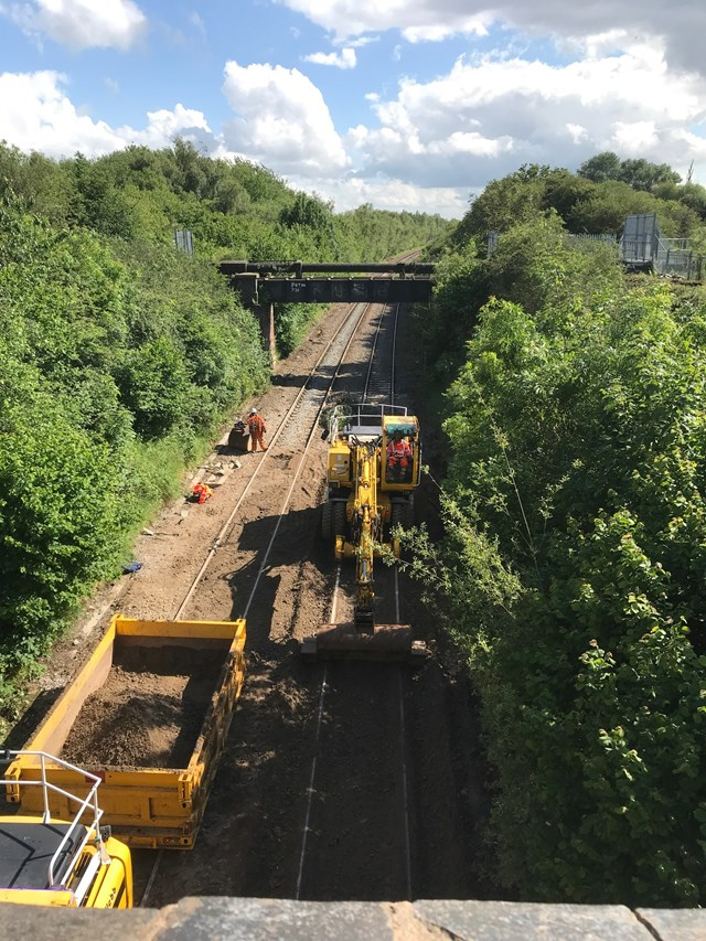 Network Rail work round the clock to reopen East Midlands railway line following landslip and flooding: Network Rail work round the clock to reopen East Midlands railway line following landslip and flooding
