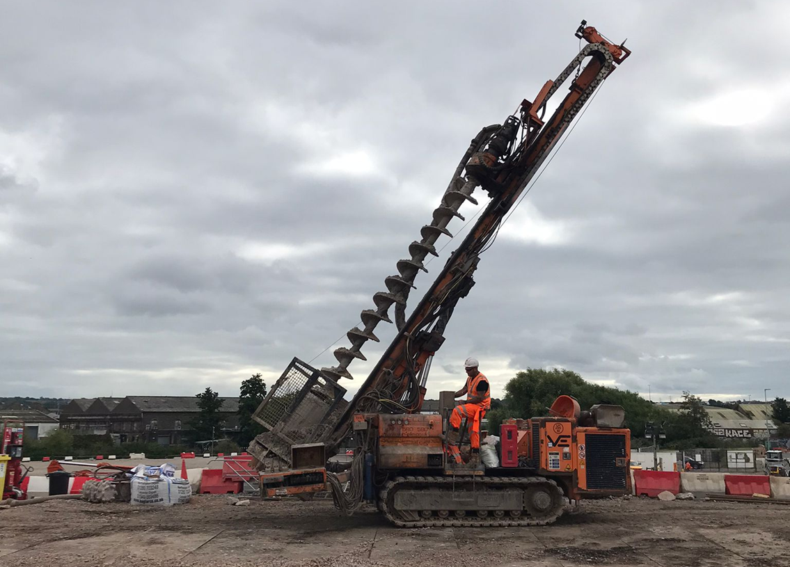 One of the large piling drills being driven by an operative