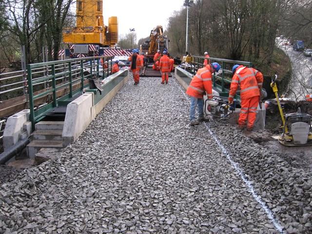 King William IV bridge: Fresh ballast being levveled on the new bridge