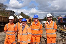 Cllr Paul Spooner and Cllr Matt Furniss join Network Rail's engineers on site at Guildford station