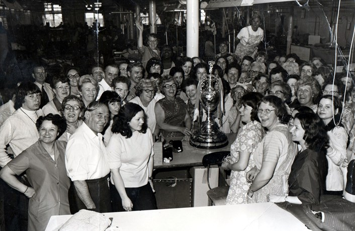 Leeds Libraries needs your help to capture names for city's family album: Hepworths Ltd staff with the 1974 football league trophy. Copyright: Leeds Libraries, Leodis.net