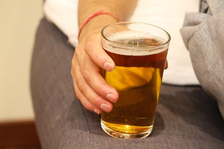 GettyImages-1180224405-man-with-drink-1024x682