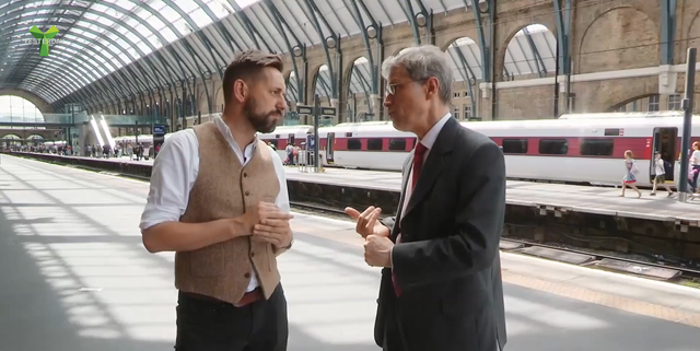 Viewers to discover the design secrets of King's Cross as part of hit railway TV series: Network Rail's Jon Burden (R) discusses the Victorian design features at King's Cross with presenter Tim Dunn (L)