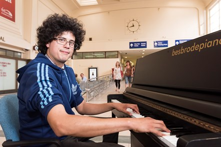 Popular Piano Is Back at Leeds Station: Nick Mitchell tinkles the keys at Leeds station