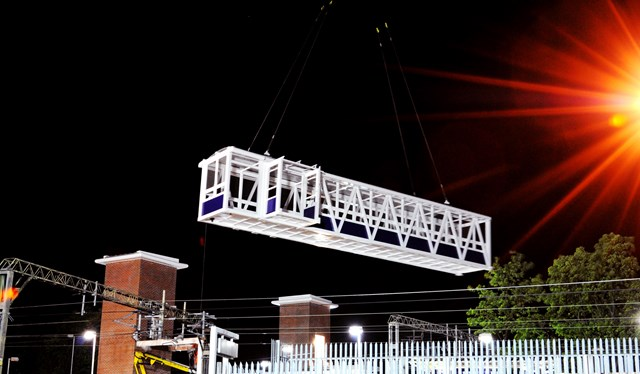 First bridge span is swung into place