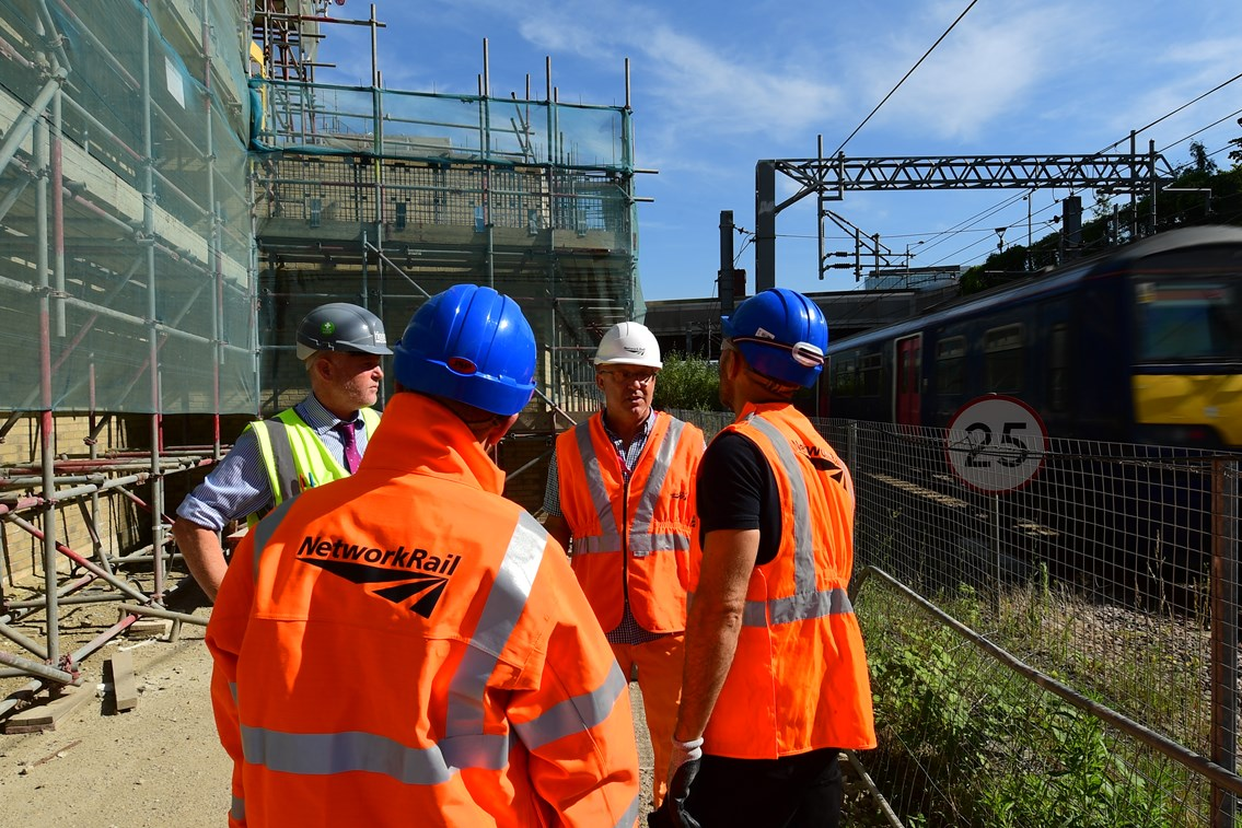 Engineer team briefing on worksite next to the railway: Open for Business, OfB, Engineer, Asset Protection and Optimisation, ASPRO, partnership, partner, client, third party, outside party, railway, building, construction, generic, worker, worksite, work, team briefing