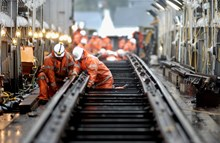 Team Orange working on the track: Track workers for Network Rail completing maintenance work.