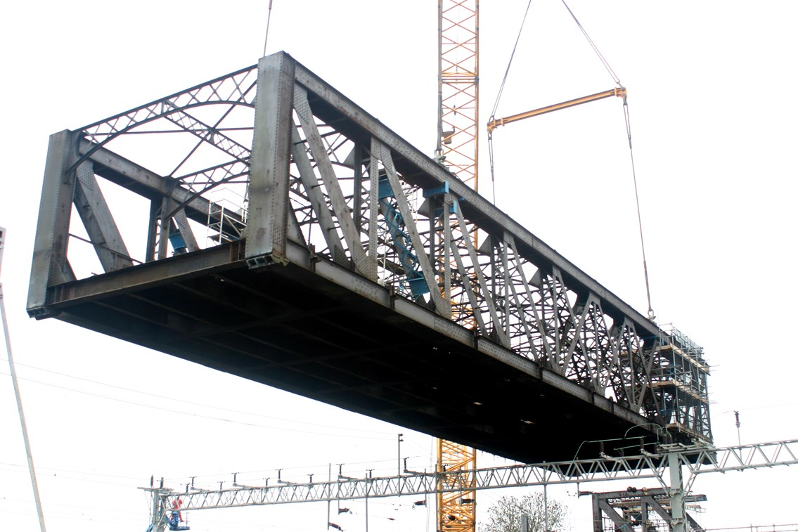 Rugby Birdcage Bridge Removal: The 'birdcage' bridge at Rugby is lifted out by a 1200 tonne crane on Christmas Day 2006.  The bridge, built in 1898 and disused since the 1960's was in a poor condition and need to be removed before it presented a risk to passengers using the West Coast Main Line underneath