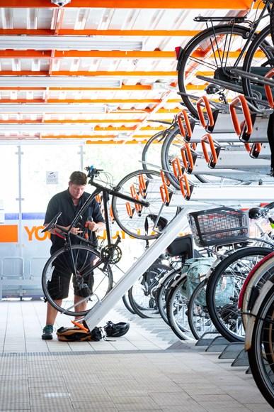 TfL Image  - A woman parking her bike