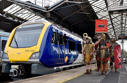 Chester 4: Roman Tours Deva Victrix herald the arrival of Northern's new train at Chester