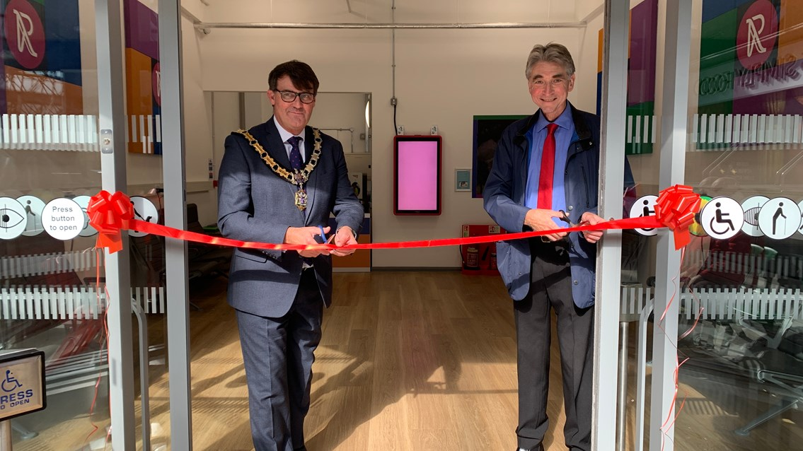 Ribbon cutting event marks official opening of new assisted travel lounge at Reading station: Mayor of Reading, Councillor David Stevens (left) cuts the ribbon with Councillor Tony Page