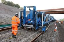Track-laying beneath bridge three at Norton Bridge
