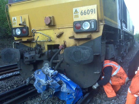 Industrial bin hit by freight train at Liphook station, Hampshire
