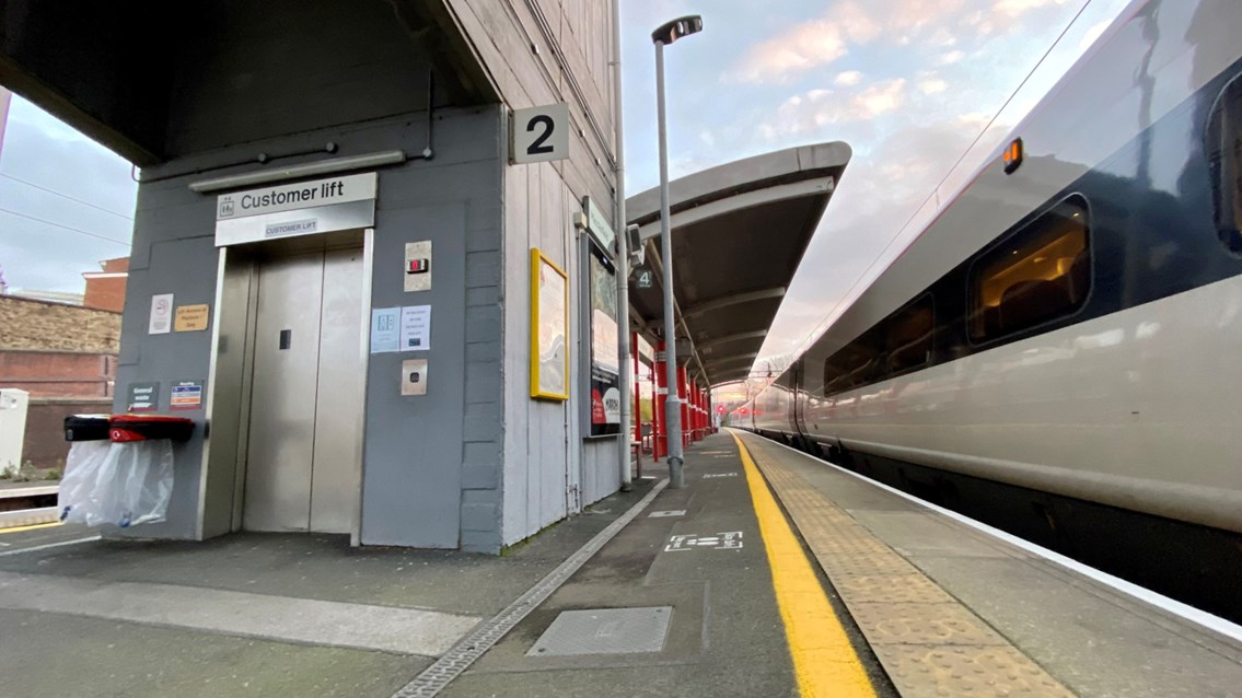 Passengers reminded of major upgrade to lifts at Macclesfield station: Macclesfield station platform 2 and 3 lift with Avanti West Coast train final