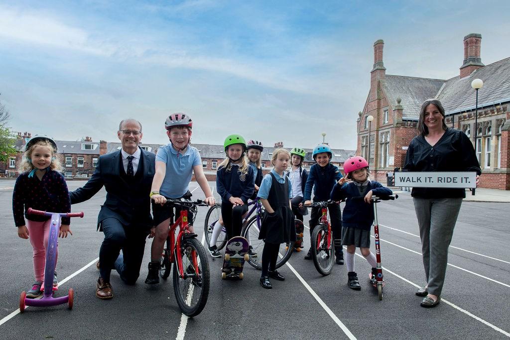 Walk it Ride it Chapel Allerton school - headteacher crouched down