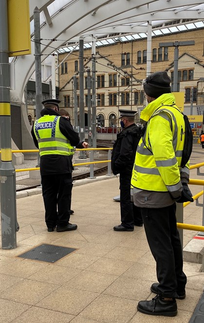 Vic DOA1: TravelSafe's Partnership staff stood on the Metrolink platform at Victoria during their 50th day of action targeting face covering compliance.