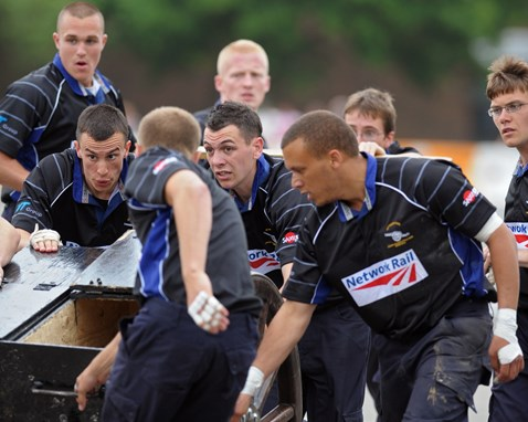 Apprentices taking part in field gun competition