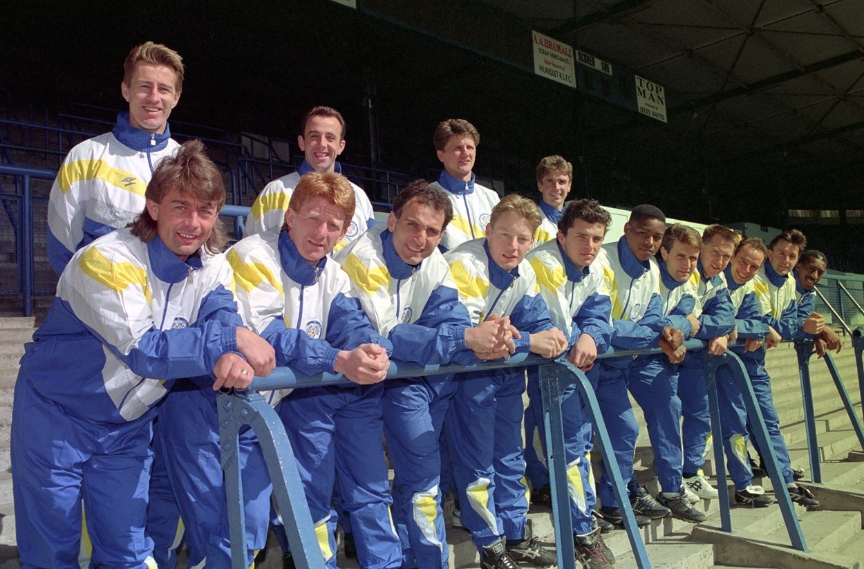 Leeds United 1990. Image: © Varley Picture Agency.: Leeds United team in 1990 wearing tracksuits in the blue and yellow colourway. The early 90s were a successful time for the team, and in 1992 Leeds won their third League trophy. Image: © Varley Picture Agency