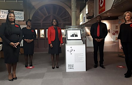 Reading Community Choir with Paul Robeson's portrait: The ensemble group of Reading Community Gospel Choir pay a visit to see the Paul Roberson portrait at Reading Museum. Left to Right: Gemma Cudjoe, Esther Fleary -Griffiths, Nicole Sanderson, Collis Keir, Sally Davey