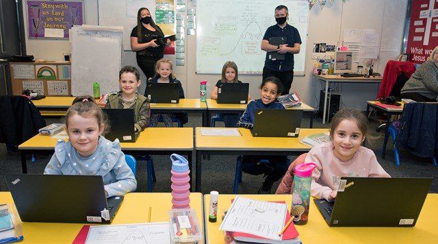Network Rail donates old laptops to help pupils learn remotely during lockdown: Network Rail donate laptops to all pupils at St Willibrords School in Manchester (1)