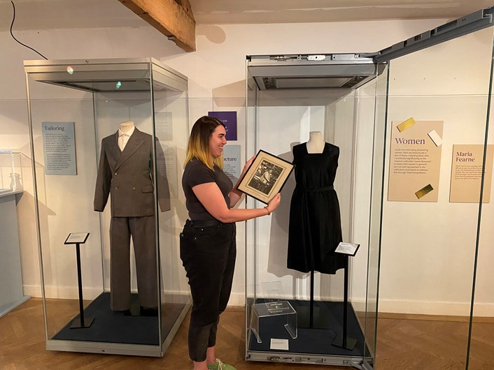 Leeds City Museum 200: Project curator Catherin Robins with a weaver's apron worn by Nellie Burnley from 1926-1930.