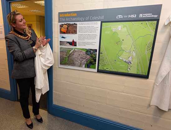 Historical findings by HS2 archaeologists go on show at Coleshill Town Hall: Coleshill Town Mayor, Councillor Caroline Symonds officially unveils HS2 archaeology exhibition